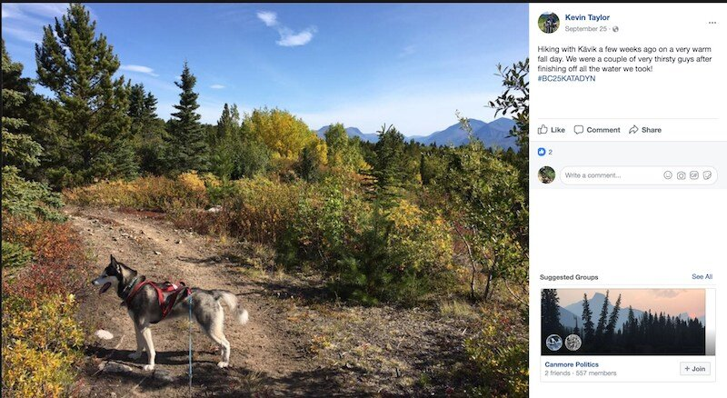 winner Kevin hiking with his dog